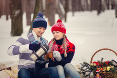 Portrait of happy couple going to drink hot tea on winter day Stock Photography