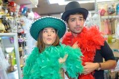 Portrait happy couple having fun trying costumes Stock Photos