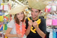 Portrait happy couple having fun trying costumes Royalty Free Stock Photo