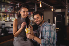 Portrait of happy couple having milkshake. In restaurant Royalty Free Stock Image