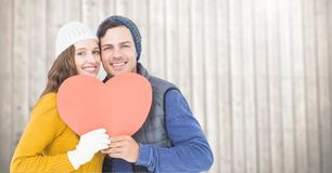 Portrait of happy couple holding hearts Royalty Free Stock Photos