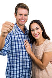 Portrait of happy couple holding home keys Stock Photo