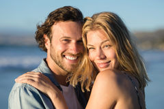 Portrait of happy couple hugging at beach Royalty Free Stock Images