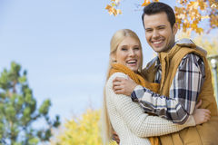 Portrait of happy couple hugging in park Royalty Free Stock Photos
