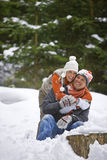 Portrait of happy couple hugging in snowy woods royalty free stock photography
