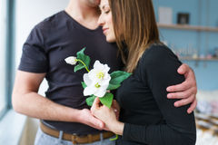 Portrait of happy couple, husband and wife with spring beautiful flower Stock Image