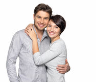 Portrait of happy couple isolated on white. Background. Attractive men and women being playful Royalty Free Stock Photos