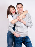 Portrait of happy couple isolated on white background. Attractive man and woman being playful. stock photos