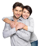 Portrait of happy couple isolated on white. Background. Attractive men and women being playful royalty free stock images