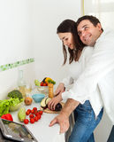 Portrait of a happy couple in the kitchen Stock Images