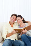 Portrait of a happy couple looking a photo album Stock Images