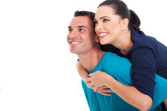 Portrait of happy couple looking up. Over white background Royalty Free Stock Image