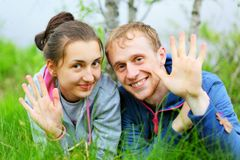 Portrait of a happy couple lying together on grass Stock Photo