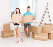 Portrait of happy couple in new home Stock Photography