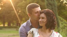 Portrait of happy couple in Park at sunset. Love. stock video footage