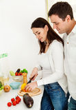 Portrait of a happy couple preparing food Royalty Free Stock Image
