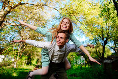 Portrait of happy couple raising their hands in open air Stock Image