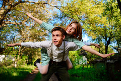 Portrait of happy couple raising their hands in open air Royalty Free Stock Photography