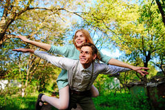 Portrait of happy couple raising their hands in open air Stock Photos