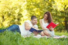 Portrait of happy couple reading book in park Royalty Free Stock Photography