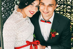 Portrait of happy couple with red accessories Royalty Free Stock Images