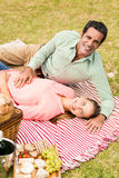 Portrait of happy couple relaxing on a blanket Royalty Free Stock Photo