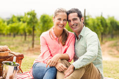Portrait of happy couple relaxing on a blanket Stock Images