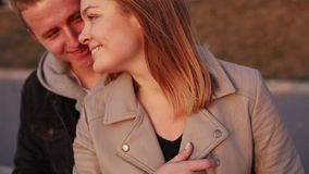 Portrait of happy couple relaxing and caressing each other stock footage