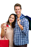 Portrait of happy couple with shopping bags and credit card Royalty Free Stock Image