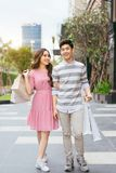 Portrait of happy couple with shopping bags after shopping in ci. Ty stock images