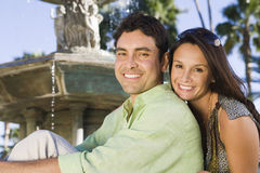 Portrait Of Happy Couple Sitting Together Royalty Free Stock Photography