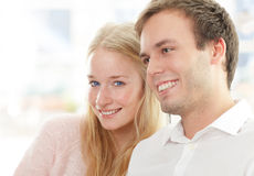 Portrait of a happy couple sitting together Royalty Free Stock Photography
