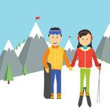 Portrait of happy couple skiers. Standing on edge of mountain peaks on background of snowy mountains in ski resort Stock Photography