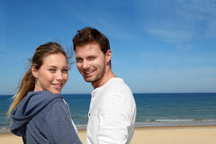 Portrait of happy couple smiling on the beach Stock Image