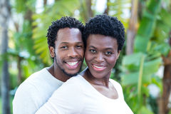 Portrait of happy couple smiling while standing Stock Photos