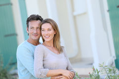 Portrait of a happy couple standing on front of the house Stock Images