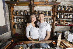 Portrait of happy couple standing together in tea store Stock Photos
