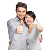 Portrait of happy couple with thumbs up sign. Isolated on white background Stock Photography
