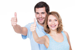 Portrait of happy couple with thumbs up. Royalty Free Stock Image