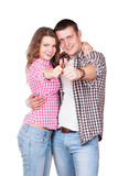Portrait of happy couple with thumbs up sign Royalty Free Stock Photography