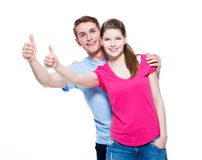 Portrait of happy couple with thumbs up. Royalty Free Stock Photography