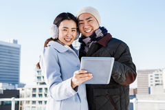 Portrait of happy couple using digital tablet Royalty Free Stock Photography