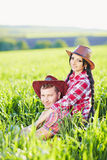 Portrait of happy couple a western style in nature. Royalty Free Stock Images
