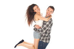 Happy young couple in casual clothes jumping Royalty Free Stock Image