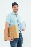 Portrait of happy courier man with parcel Stock Image