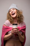 Portrait of happy curly girl drink tea or coffee from paper cup on white background. Royalty Free Stock Photography