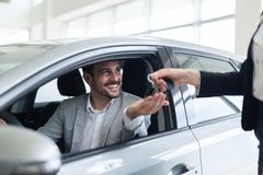 Portrait of happy customer buying new car. In salon stock photos