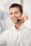 Portrait of happy customer service operator. Working in bright office Royalty Free Stock Photo