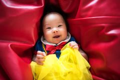 happy cute Asian baby with fantasy dress royalty free stock photography