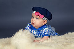 Portrait of happy cute baby girl in sailor dress Stock Images